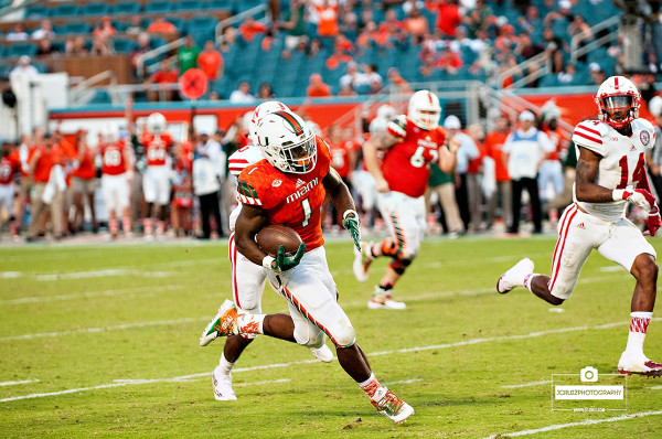 Mark Walton runs against Nebraska