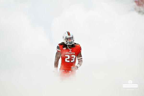 Terry McCray runs through the smoke