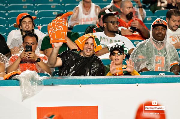 miami hurricane fans in the rain