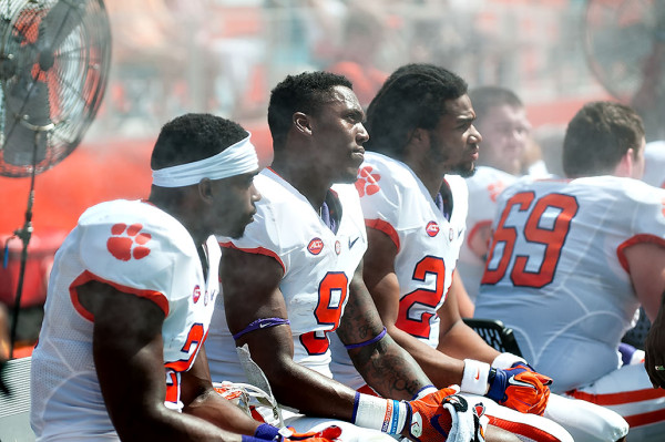 Clemson Tigers players cool off under the fan at Sunlife Stadium