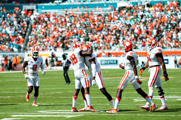 Clemson safety #18, Jadar Johnson, celebrates his interception with teammates