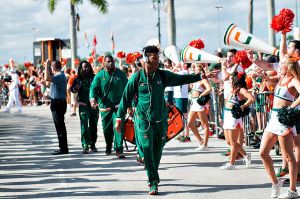 Miami Hurricanes safety #2, Deon Bush, greets fans along the Hurricane Walk