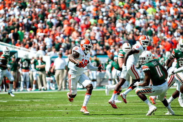 Clemson Tigers safety #18, Jadar Johnson, runs back an interception against the Miami Hurricanes