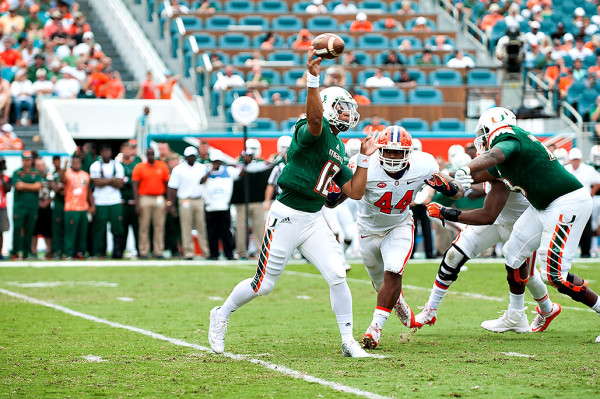 Hurricanes QB #12, Malik Rosier, attempts a pass against Clemson