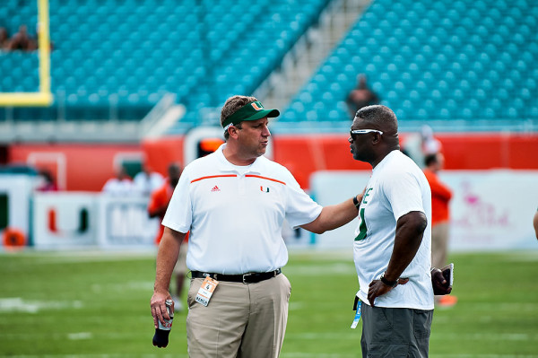 Hurricanes defensive coordinator, Mark D'Onofrio, explains to Hurricanes legend, Alonzo Highsmith, how his defensive scheme works