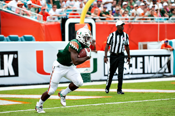 Hurricanes RB #1, Mark Walton, returns a kickoff