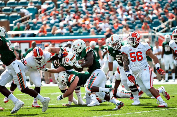 Miami Hurricanes RB #2, Joe Yearby, rushes against the Clemson Tigers