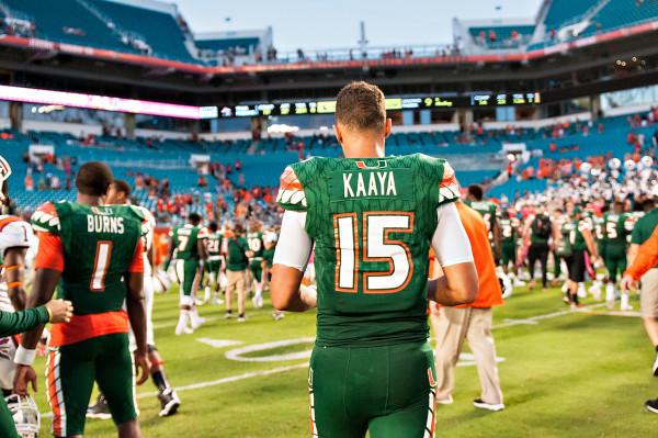 Miami Hurricanes QB #15, Brad Kaaya, walks back to the lockerroom after beating Virginia Tech