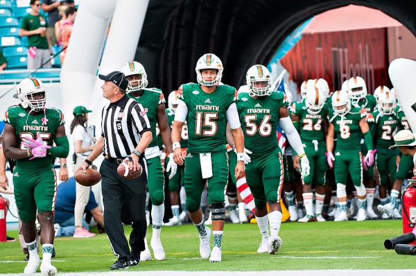 Miami Hurricanes QB #15, Brad Kaaya, leads the team captains out for the coin toss