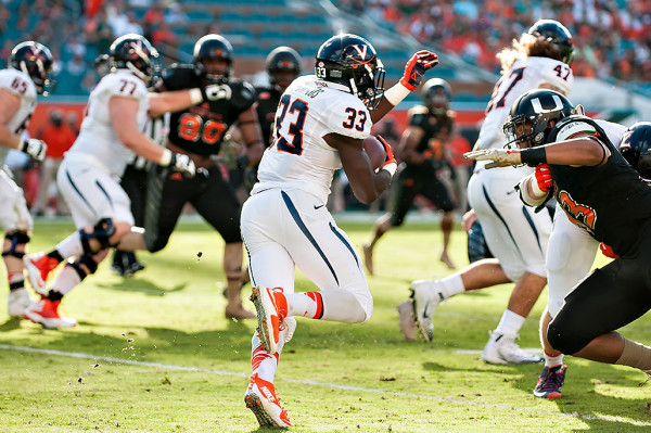 Virginia RB Olamide Zaccheaus cuts back inside against the Miami defense