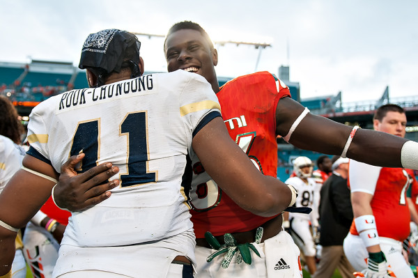 David Njoku and Rod Rook-Chungong greet each other after the game