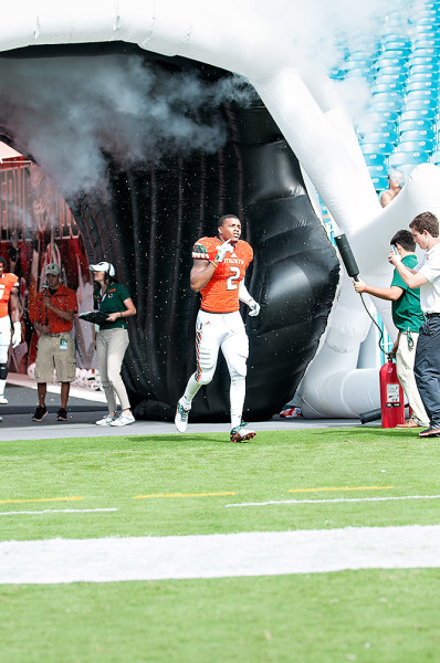 Deon Bush runs out the tunnel for Senior Day