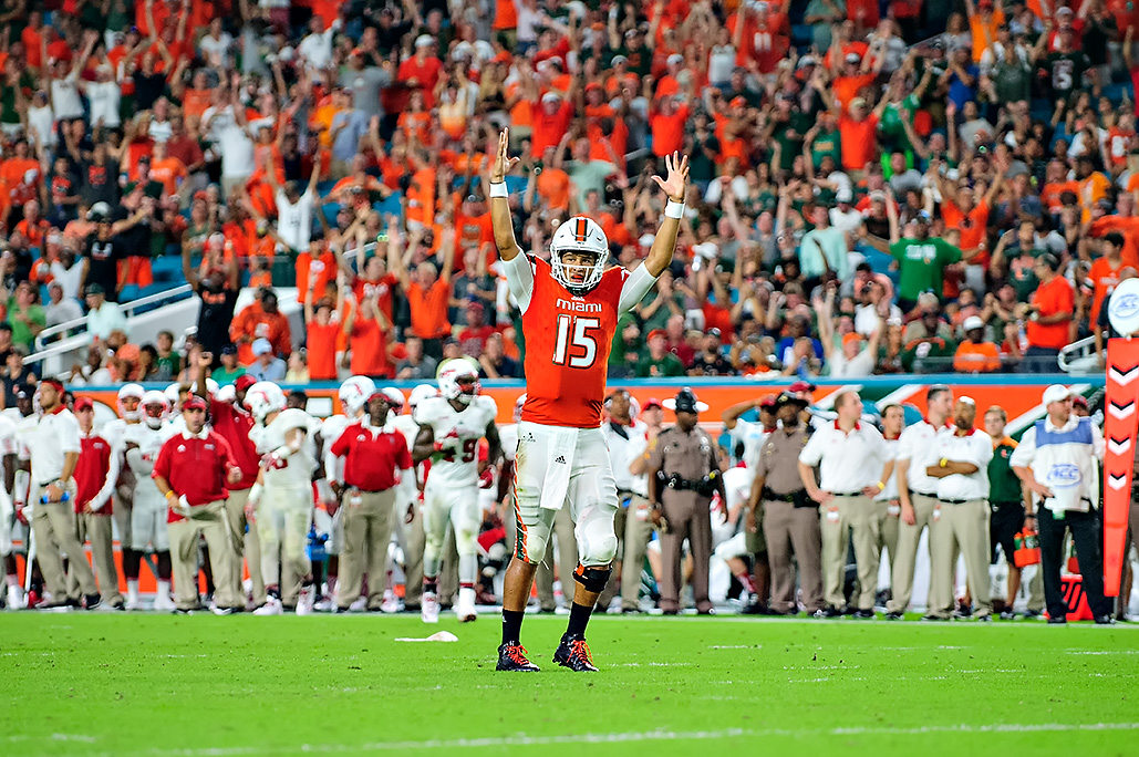 Hurricanes QB, Brad Kaaya, celebrates a Mark Walton rushing touchdown