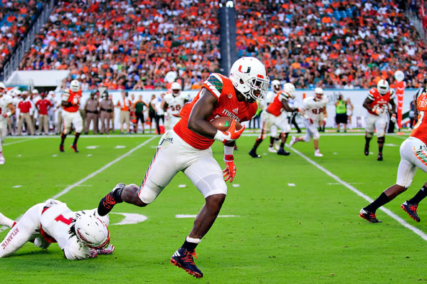 Hurricanes TE, Christopher Herndon, eludes a tackle and heads up the sideline