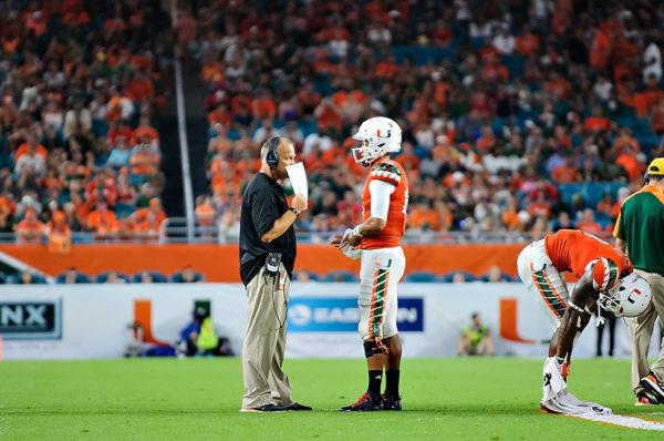 Brad Kaaya and Mark Richt talk strategy during a timeout