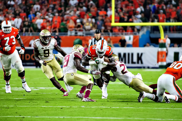 Hurricanes TE, David Njoku, tries to break through two FSU defenders