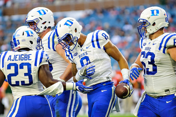 Duke WR, Aaron Young, celebrates with teammates