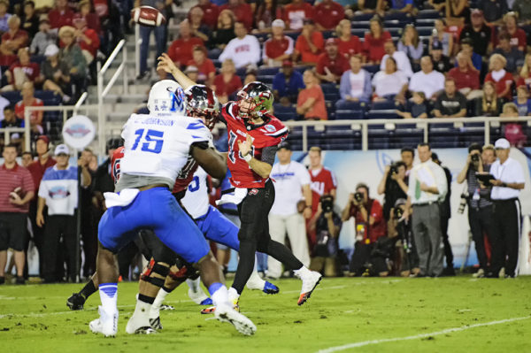 Mike White, Western Kentucky QB, throws a pass from the pocket