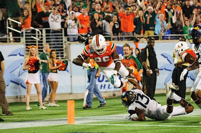 Miami Hurricanes TE, David Njoku, leaps over a defender into the endzone for a touchdown