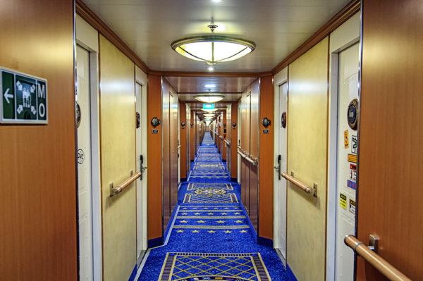 Hallway full of Disney Magic staterooms
