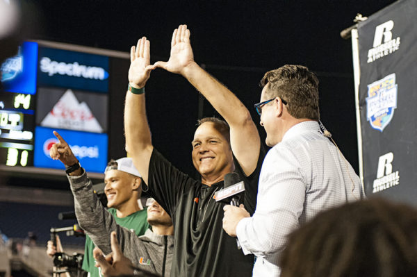 Mark Richt throws up the U at the conclusion of his interview