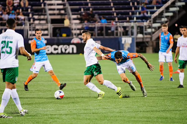 New York Cosmos midfielder, Juan Guerra, tries to keep the ball away from Vincenzo Rennella