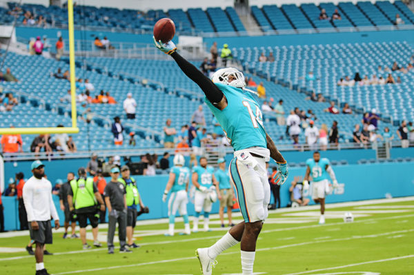 Dolphins WR #14, Jarvis Landry, works on his one handed catches
