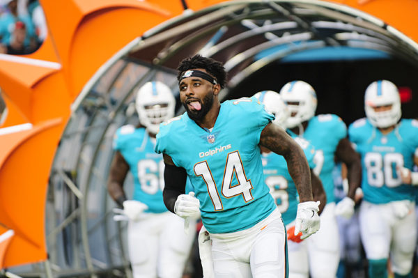 Dolphins WR #14, Jarvis Landry, runs out through the tunnel