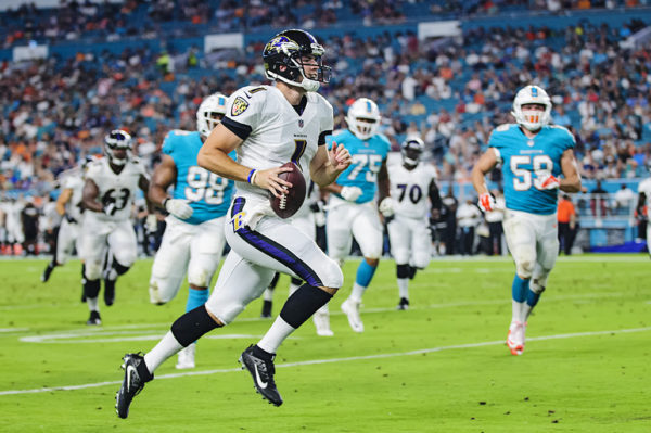 Ravens QB #1, Josh Woodrum, rushes in for a touchdown