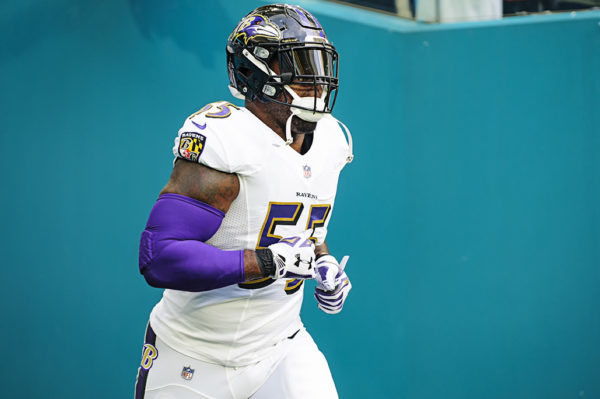 Ravens LB #55, Terrell Suggs, jogs onto the field
