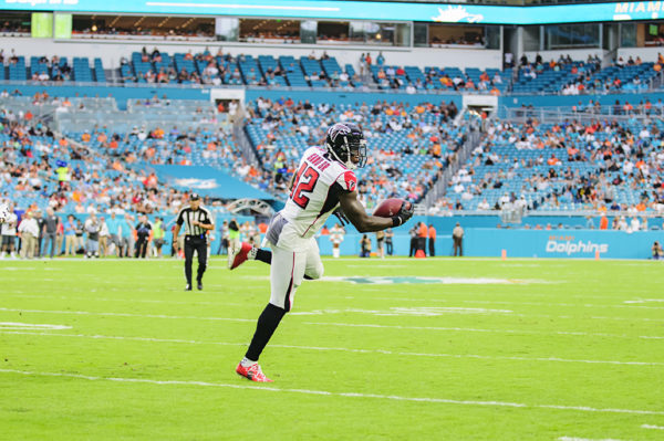 Falcons WR, #12 Mohammed Sanu, uses one hand to haul in a pass from Matt Ryan