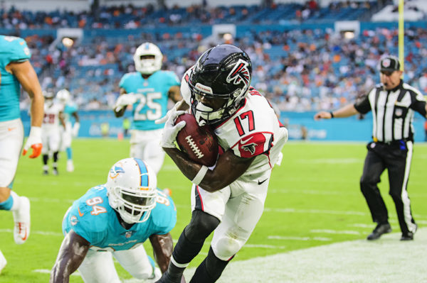 Falcons WR, #17 Marvin Hall, gets pushed out of bounds after making a catch