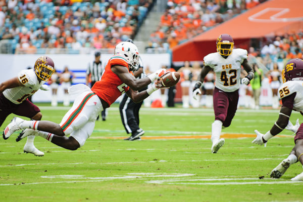 Hurricanes TE, Christopher Herndon, leaps to make a catch