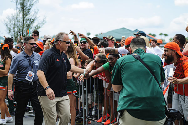 "Miami head coach, Mark Richt, greets fans during ""Canes Walk"""