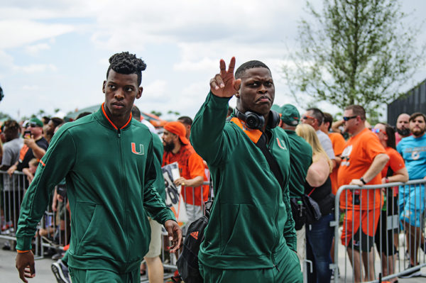 Hurricanes LB, Shaquille Quarterman, waves to fans