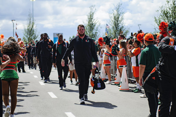 Miami Hurricane players participate in the Canes Walk