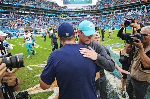 Both head coaches meet at midfield after the game