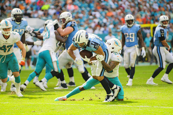 Eric Decker gets tackled by Xavier Howard