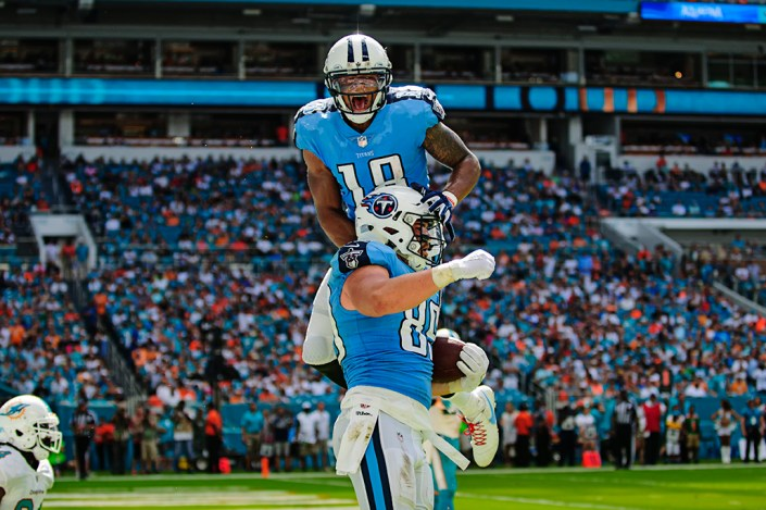 Rishard Mattews jumps on Phillip Supernaw's back to celebrate the touchdown