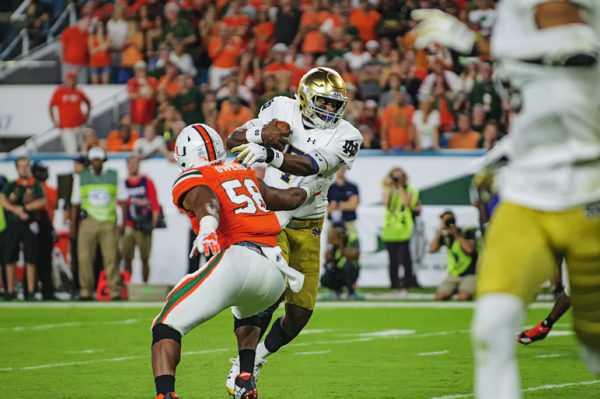 Brandon Wimbush (7) runs past Darrion Owens (58) to convert the 2 point conversion