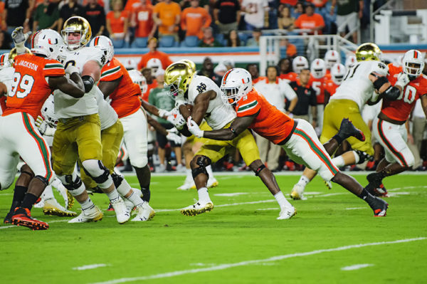 Chad Thomas (9) wraps up Josh Adams (33)