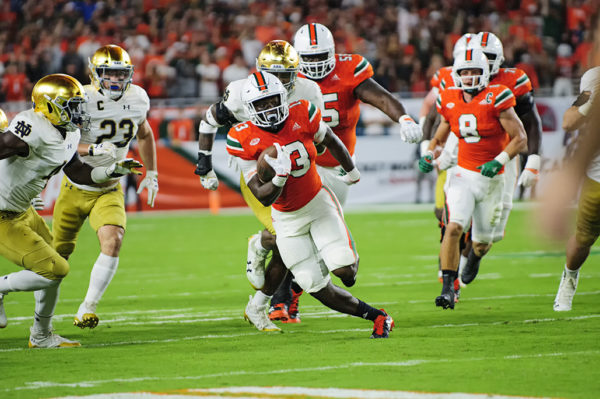 DeeJay Dallas (13) runs upfield