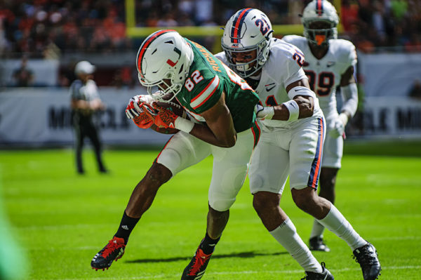 Ahmmon Richards (82) gets tackled by Juan Thornhill (21)