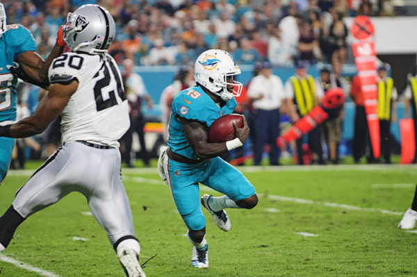 Jakeem Grant (19) tries to find a hole to run through on a kickoff return