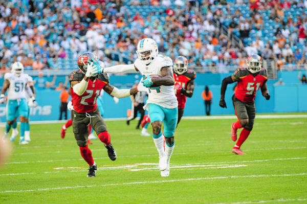 Jarivs Landry (14) extends a stiff arm
