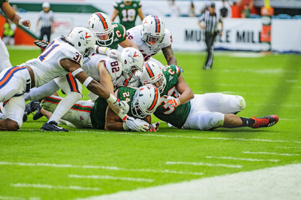 Travis Homer (24) recovers a fumble