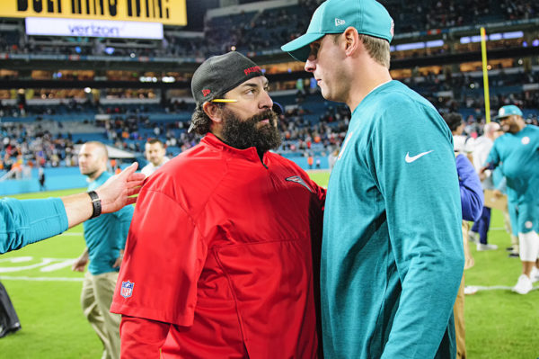 Dolphins head coach Adam Gase and Patriots Defensive Coordinator Matt Patricia talk after the game