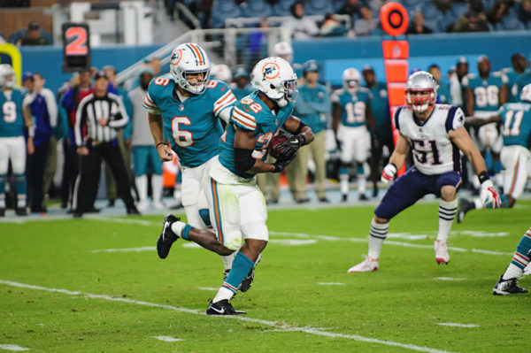 Jay Cutler hands off to Kenyan Drake