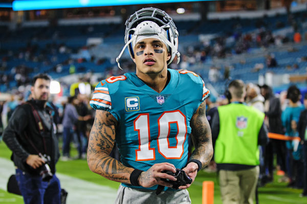 Dolphins WR, Kenny Stills, walks to the stands to give fans his gloves