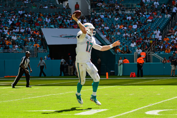 Miami Dolphins quarterback Ryan Tannehill (17) throws on the run